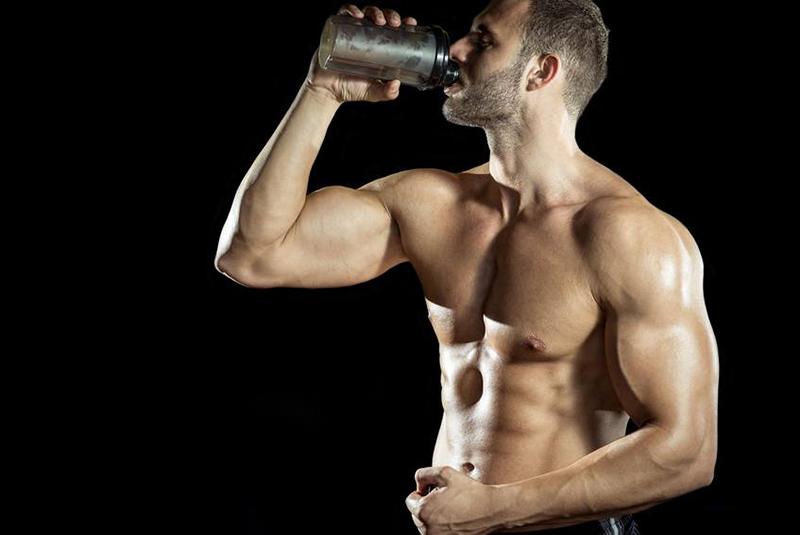 man-drinking-pre-workout
